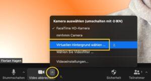 """Neue virtuelle Hintergründe werden in Zoom über das Pfeilsymbol und Wahl von """"Virtuellen Hintergrund wählen..."""" zugefügt."""